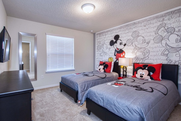 Hideaway children's bedroom with black bedroom set with Mickey Mouse theme and grey bedding