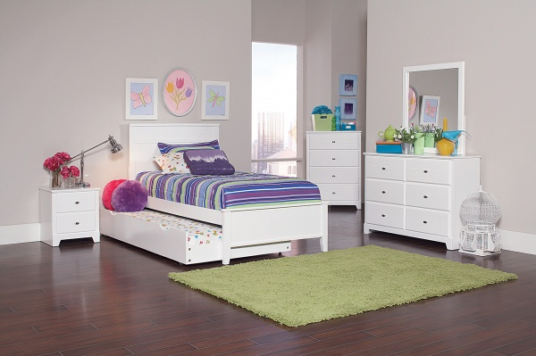 sterling plus secondary suite featuring an all white wood bedroom set with purple, olive, and pink accents and bedding