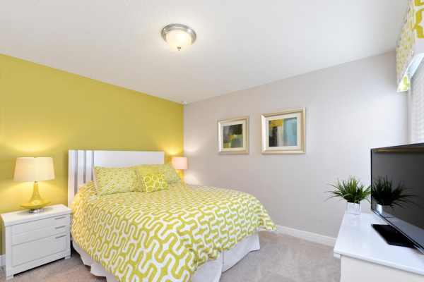 Eaglebay bedroom with white bedroom set with yellow and white accents and bedding