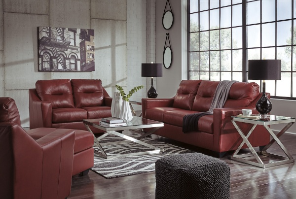 executive living room featuring red leather sofas with square metal glass top tables and black accents