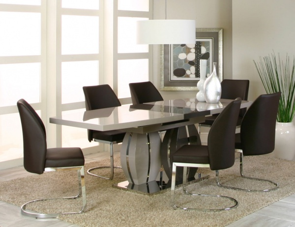 executive dining room featuring modern dining room table with six metal based chairs with black leather upholstery