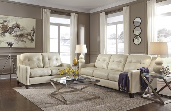 executive living room featuring cream colored leather sofas with square metal glass top tables