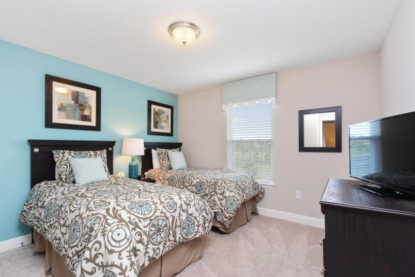 Eaglebay secondary suite with black wood bedroom set with multicolored accents and bedding