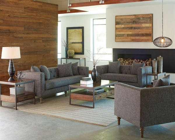 executive living room featuring brown material couches with brown wooden furniture with cream striped area rug