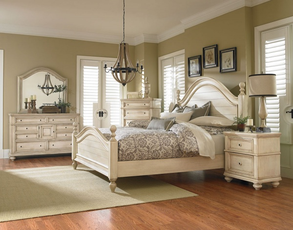 executive master suite featuring cream wooden bedroom set with cream and taupe accents and bedding