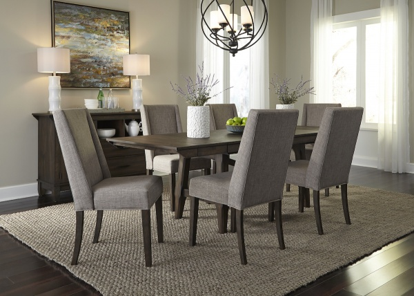 executive dining room featuring elegant wooden dining room table with six wooden legged chairs with grey cloth upholstery